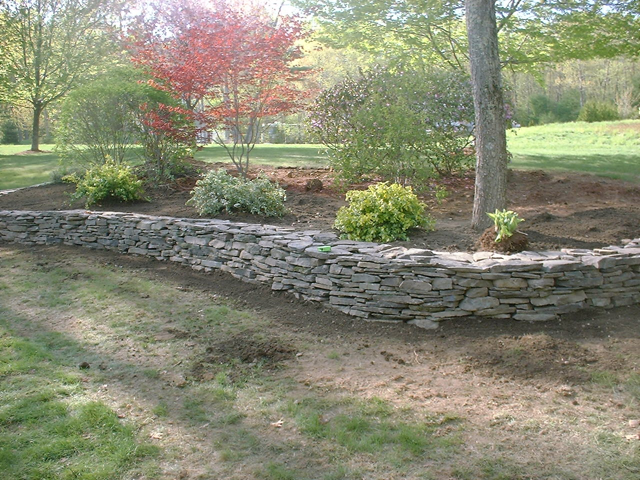 Natural Rock Retaining Wall And Flower Beds Salem Nh Labrie Property Maintenance And Landscaping