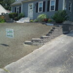 New Belgard Retaining wall, Walkway with Granite steps, Granite Staircase, planters and hydro-seeding.