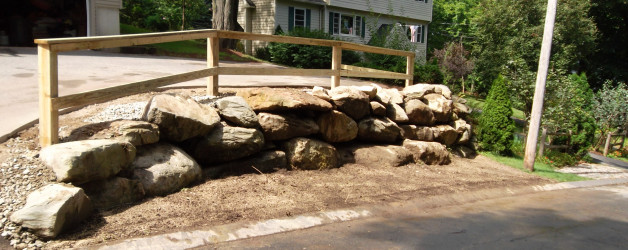 New Retaining Wall, Wooden Fence, and Installation of Stone for Drainage